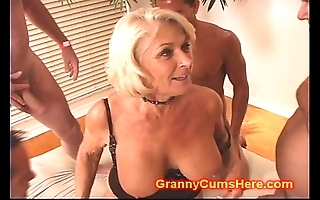Granny acquires a gang bang with an increment of cum bath