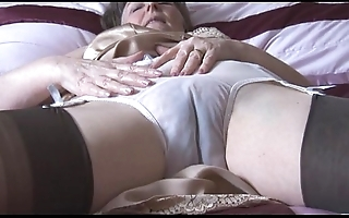 Flimsy granny wide slip coupled with nylons with espy thru small-clothes disrobes