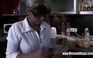 Mature stepmom comforting a wink hearted stepson