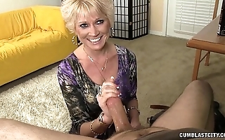 Topless granny splattered close to cum