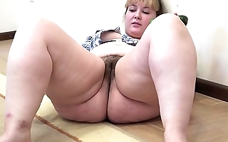 A chunky cookie nearly a soft snatch masturbates nearly a cucumber