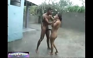 Untamed jungle copulates sexy woman at near downpour in the moistened rain
